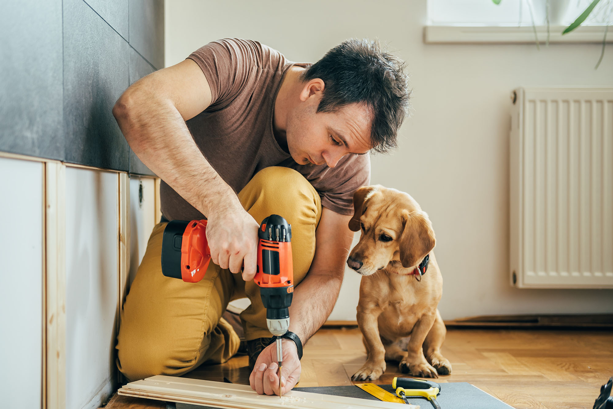 Man,Doing,Renovation,Work,At,Home,Together,With,His,Small